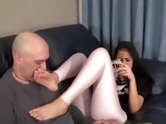 step-daughter puts her feet on the dads face